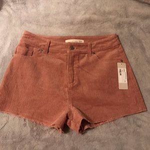 Nude pink cord shorts with frayed hem size medium